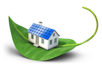 Solar cell house icon on green leaf - Alternative energy